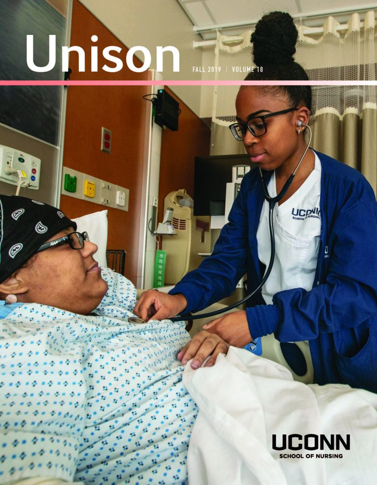Cover of the 2019 UNISON magazine shows a young nurse listening to a patient's heartbeat with a stethoscope