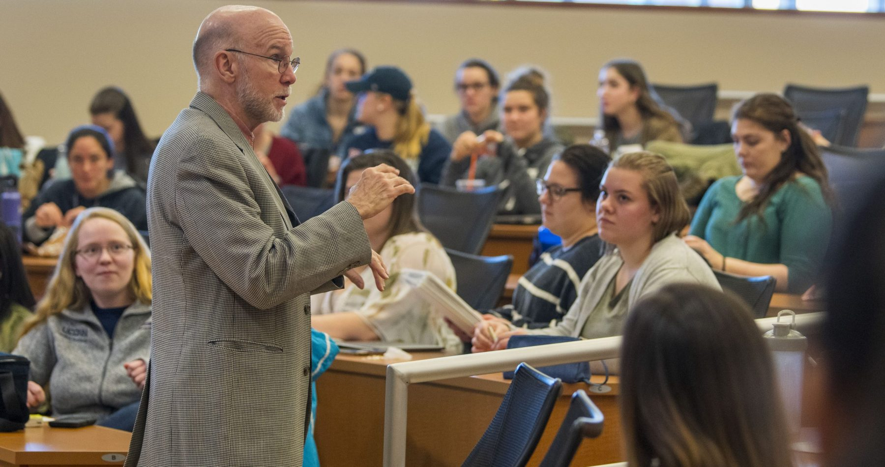 Professor Thomas Long gives a lecture in the Widmer Wing of the School of Nursing.