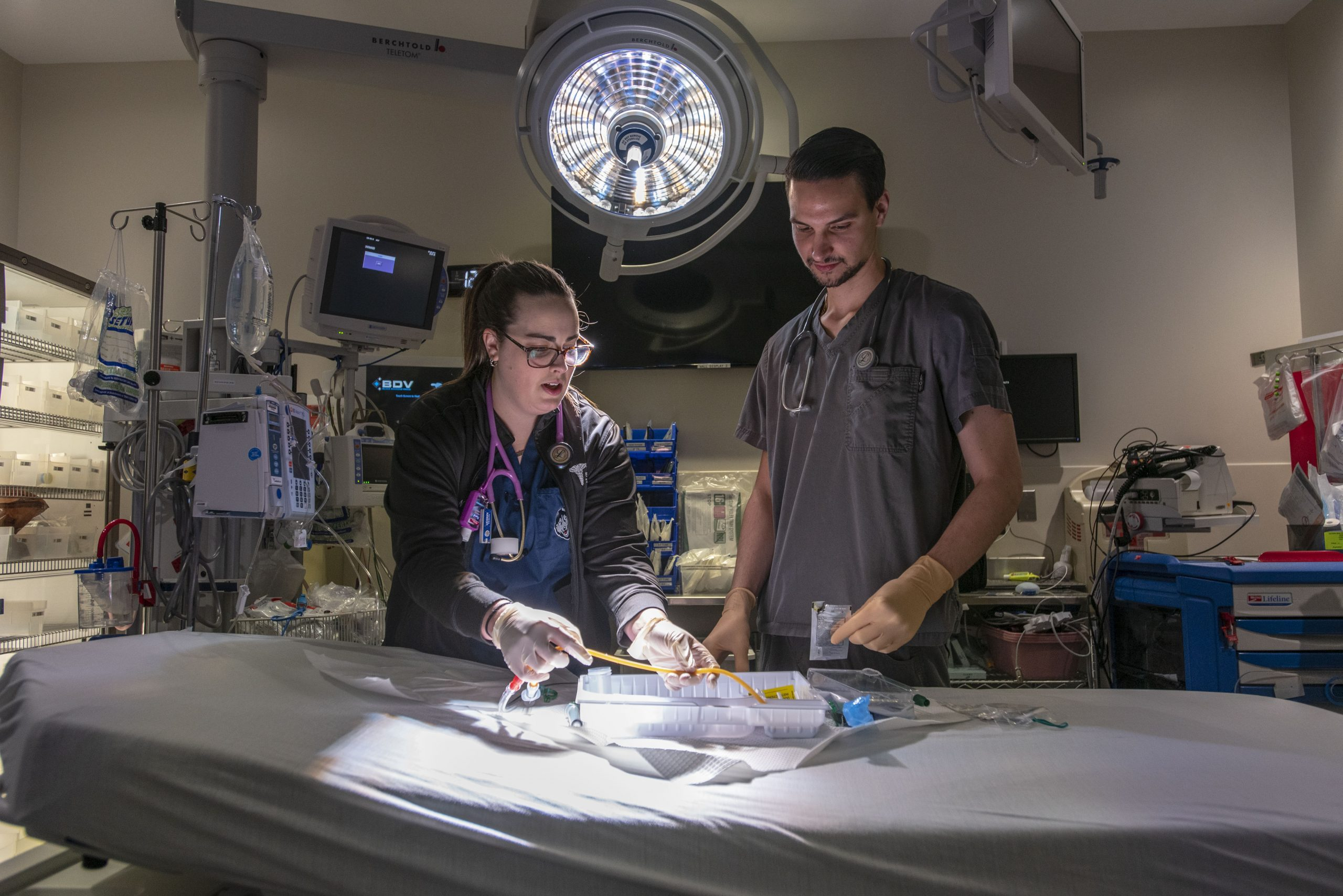 Clinical instructor Amanda Moreau teaches a student in the Emergency Department of UConn Health.