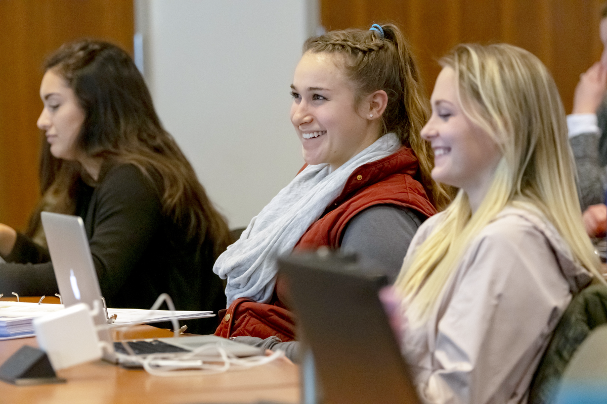 Students listen to a lecture by Clinical Instructor Valarie Artigas at the Widmer Wing of the School of Nursing.